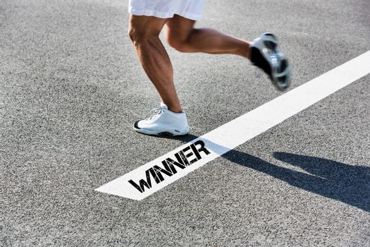 Man stepping on white line with winner sign