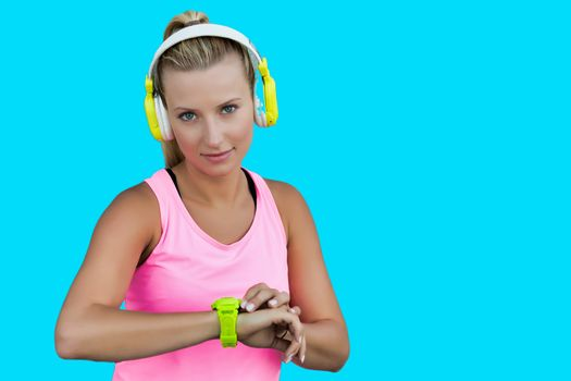 Cutout of young active woman listening music with headphones on