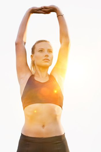 Cutout of young active attractive woman stretching her arms