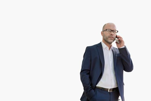 Cutout of mature businessman talking on smartphone