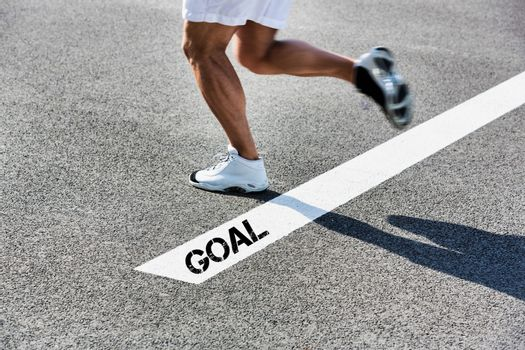 Man stepping on white line with goal sign