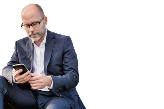 Cutout of mature businessman using smartphone