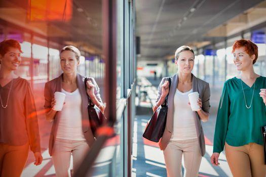 Portrait of businesswomen walking while talking