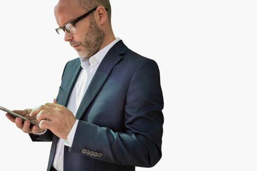 Cutout of businessman using smartphone while leaning on wall