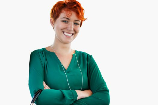 Cutout of smiling confident businesswoman standing with arms crossed