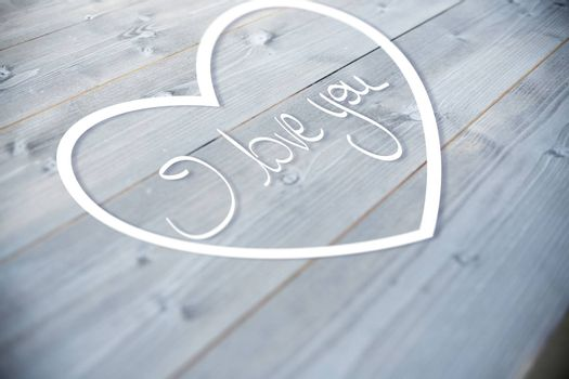 Valentines love hearts against bleached wooden planks background