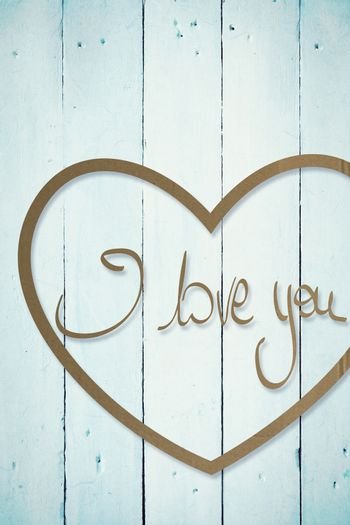 Valentines love hearts against painted blue wooden planks