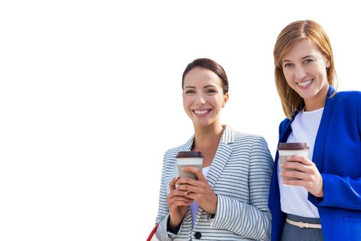 Cutout of businesswomen holding cup of coffee