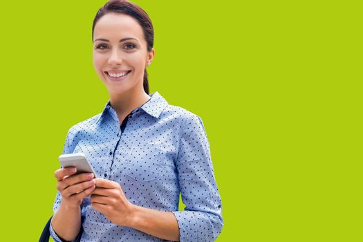 Cutout of young attractive businesswoman using smartphone