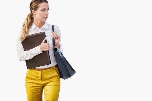 Cutout of young attractive businesswoman holding documents