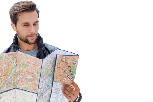 Cutout of young attractive man looking on the map in the city