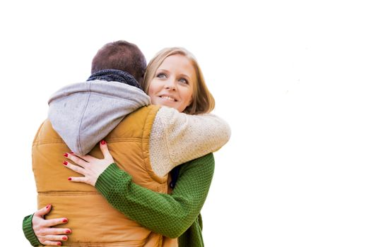 Cutout of mature couple embracing each other while wearing winter clothes