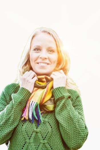 Cutout of Beautiful woman standing and smiling while holding her scarf