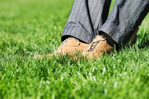 Close up of businessman foot on the grass
