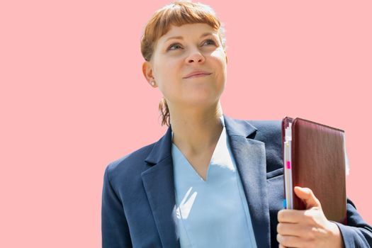 Cutout of young attractive businesswoman holding document