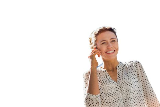 Cutout of young attractive woman talking on smartphone