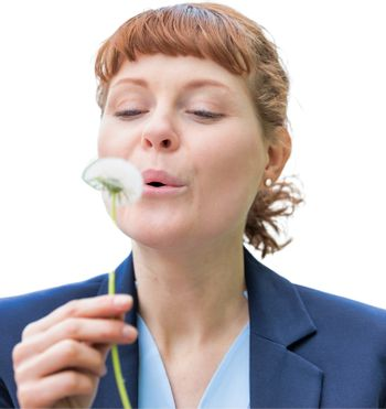 Cutout of young attractive businesswoman wishing on dandelion