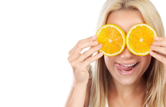 Funny girl with oranges