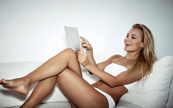 Nice female with tablet at home