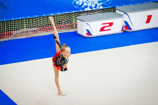 Adorable gymnast participates in competitions in rhythmic gymnastics