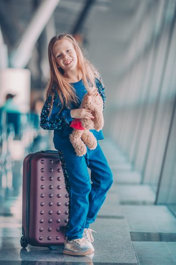 Little kid in airport waiting for boarding