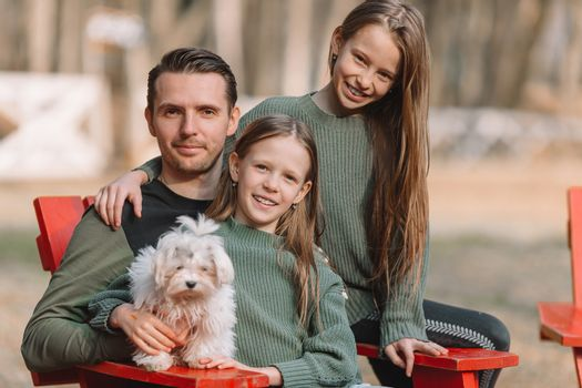 Family with cute puppy outdoor in the park