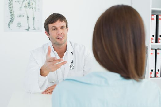 Doctor listening to patient with concentration at medical office