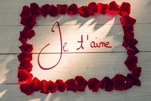 Valentines love hearts against frame of rose petals