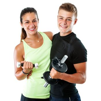Close up portrait of attractive healthy teen gym couple with dumbbells.Isolated on white background.