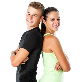 Close up portrait of attractive teen couple in sportswear standing back to back.Isolated on white background.