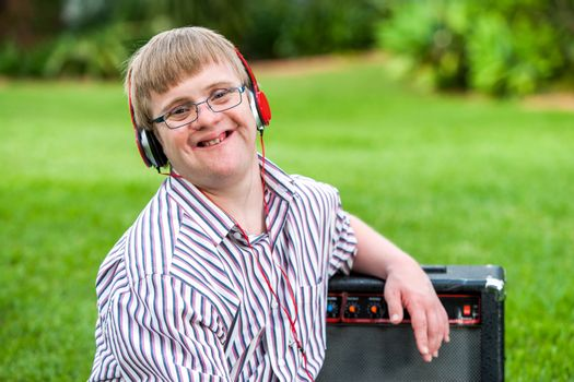 Boy with down syndrome wearing headphones.