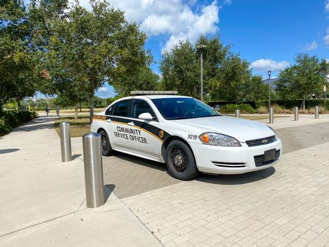 Orlando, FL/USA-5/6/20: A University of Central Florida Community Service Officer patrol car parked on the UCF School of Medicine Campus in Orlando, Florida.