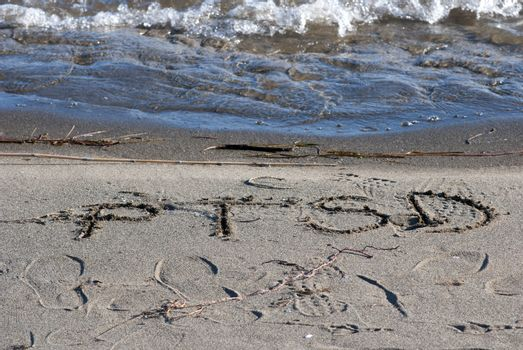 ptsd text on a beach sand, mental health concept