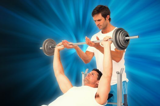 Composite image of trainer helping fit man to lift the barbell bench press