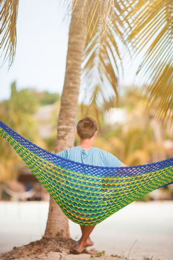 Lazy time. Man in hat in a hammock on a summer day