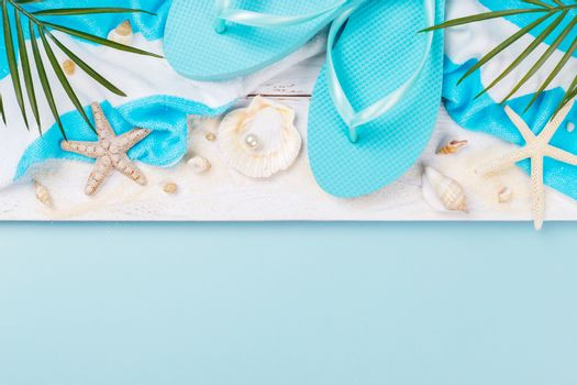 Beach accessories on the blue background