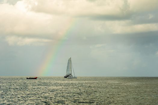 Catamaran at Rodney bay with rainbow in the backround, Saint Lucia, Caribbean sea