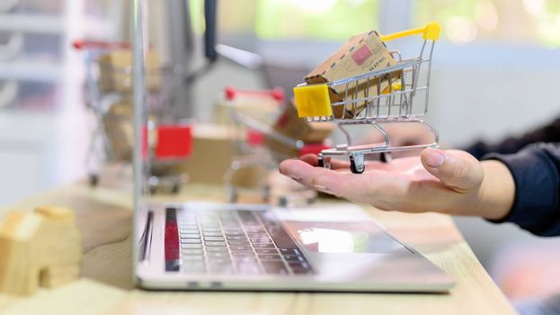 Online shopping and home delivery concept. Lock down and Self-quarantine for work home. SME business and e-commerce effect from Covid-19.