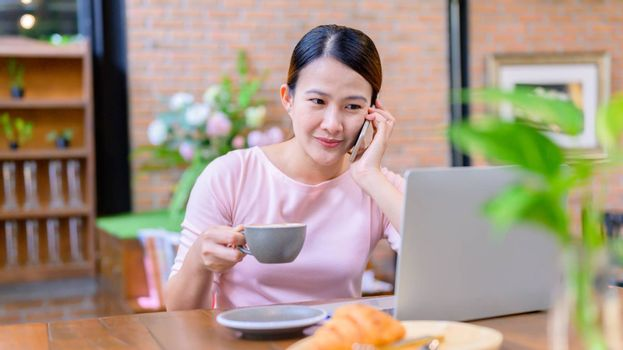 Asian businesswoman working online. New normal and life after COVID-19. Stay home stay safe. Social Distancing and Physical Distancing.