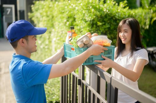 Food delivery when Lock down and Self-quarantine at home. New normal and life after COVID in Thailand, Asia. Social distancing and stay home stay safe.