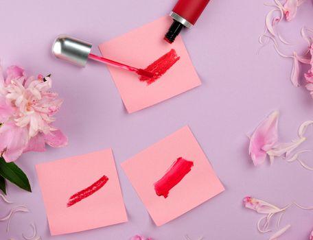 liquid lipstick and a smear of red lipstick