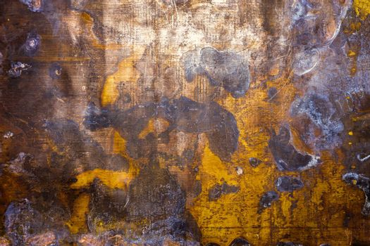 texture and background of old oxidated sheet of brass with with white patina stains and spots and some minor scratches.