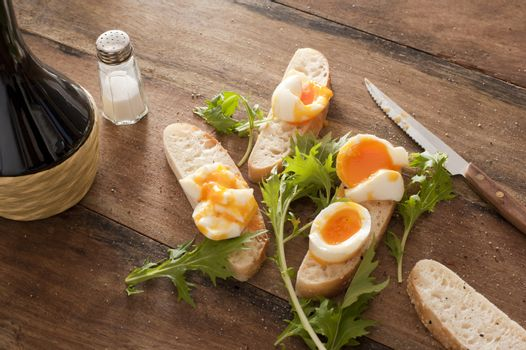 Fresh rolls with boiled eggs and rocket