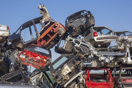 Old cars stack - Car junkyard - damaged vehicles waiting for rec