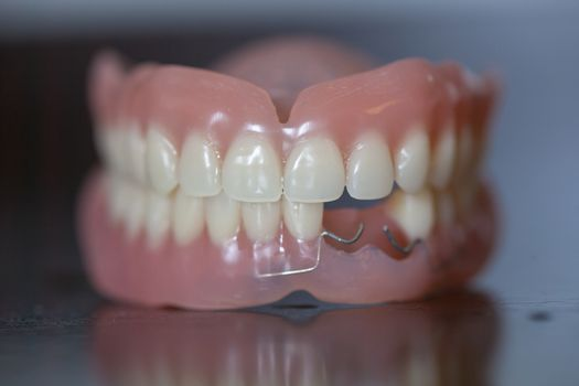 Set of medical denture on dark table