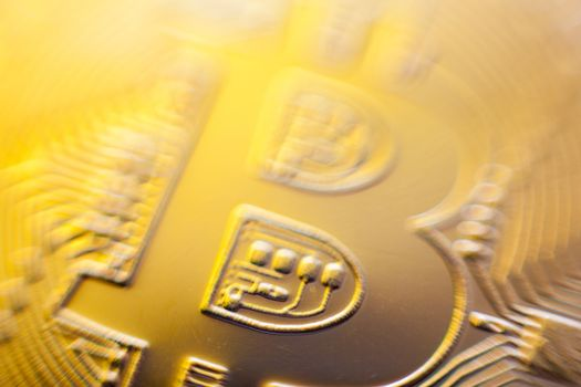Gold light of Bitcoin currency coin extreme close-up
