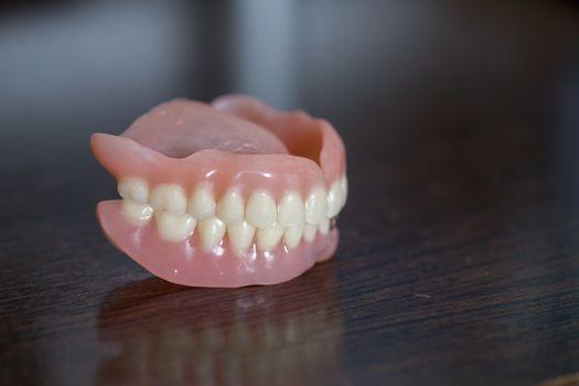 Full set of Medical denture on table
