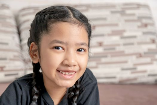 Asian girl in a black braid is smiling