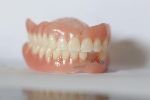 Acrilyc medical denture on white table