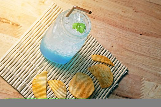 Blue ice tea art coffee on wooden texture table